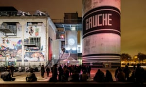 At night, gig-goers hang outside La Sucrière, a huge arts and music space, formerly a sugar warehouse, in Lyon, France.
