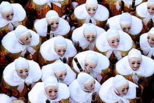 'Gilles of Binche' dance during a carnival parade in the city centre of Binche, Belgium.