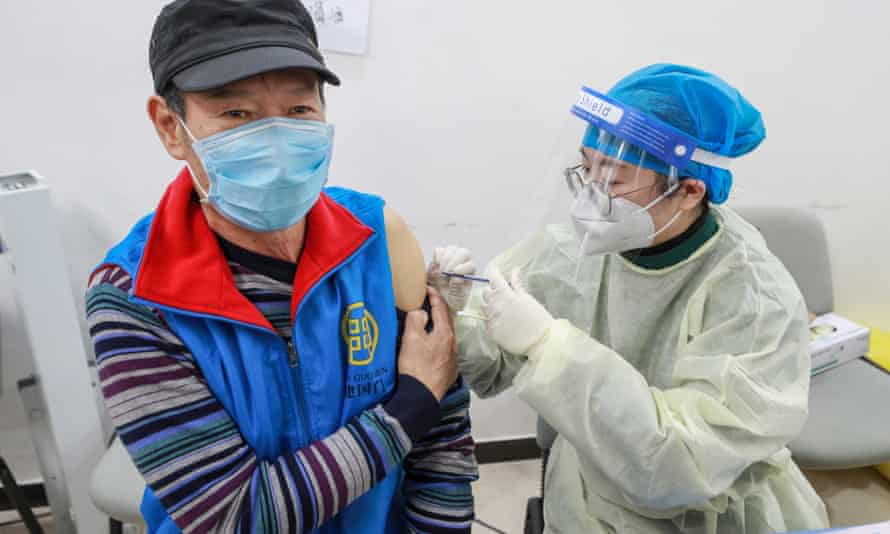 A man receives a Covid-19 vaccine in Beijing. China's first locally transmitted case for weeks had been given the jab.