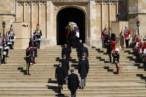 Mourners walk up steps to chapel