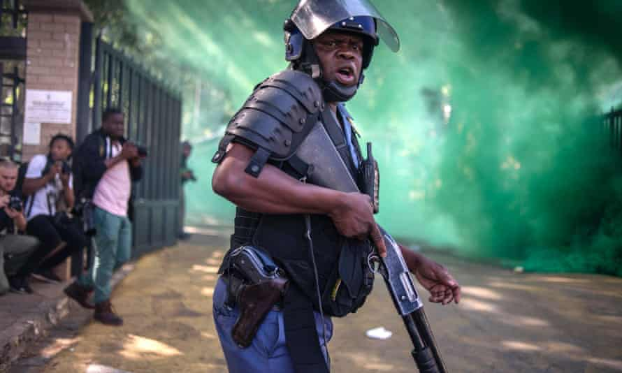 A police officer looks on during a protest at the University of the Witwatersrand in Johannesburg.