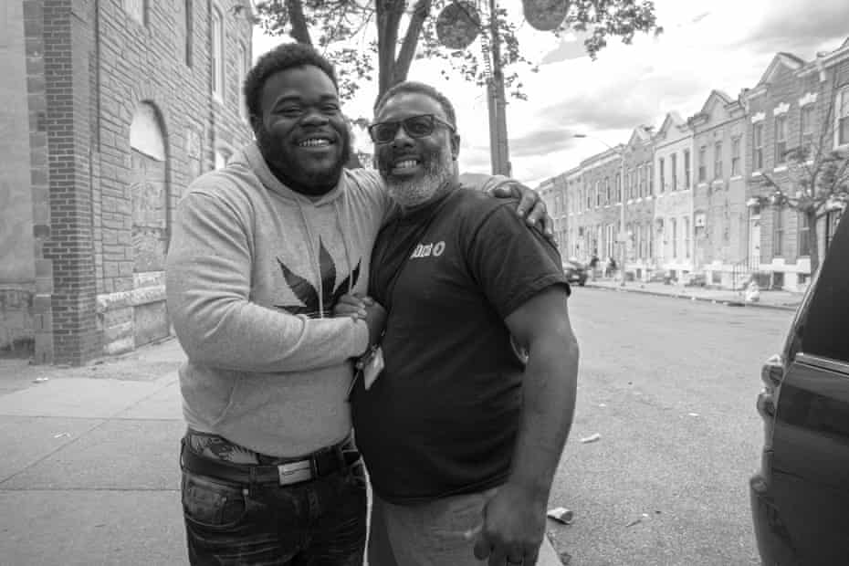 Teshombae Harvell embraces one of the Roca clients he has spent months working with in East Baltimore.