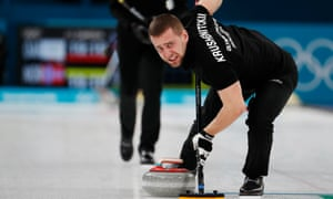 Alexander Krushelnitsky in action during the curling finals at the Winter Olympics.