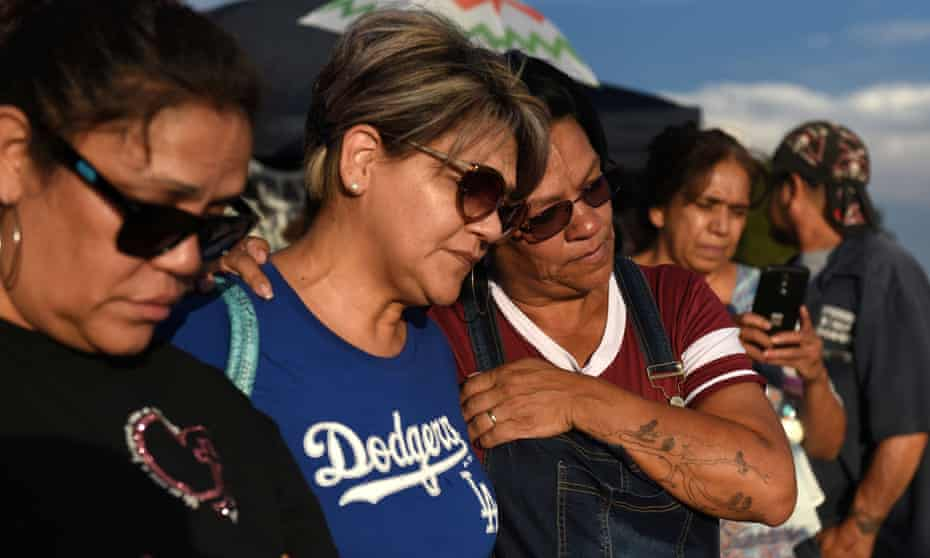 Esther Estrada, Maria Ramirez and Emily Grondahl visit a memorial four days after a mass shooting at a Walmart store in El Paso.