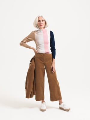 Model brown wears blazer, £99, and brown cropped trousers, £65, both marksandspencer.com. pink white brown black striped jumper, £225, paperlondon.com. white trainers, £135, whistles.com.