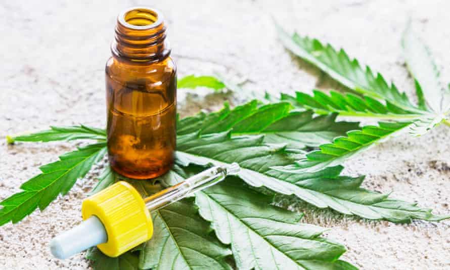 Cannabidiol oil and marijuana leaf