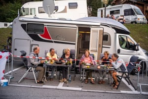 A Dutch family of two brothers and one sister and their husbands and wives eat dinner after coming together to support the Jumbo team and their leader Primos Roglic ahead of the 17th stage in Meribel, France. This is the fourth time the siblings have attended to the tournament together and their third stage for this year.