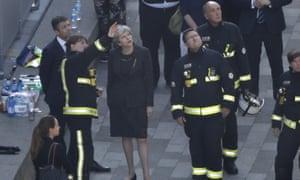 Theresa May speaks to members of London fire brigade