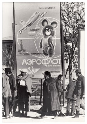 A street scene from Kabul, Afghanistan, in 1980 reflects the Soviet presence after its invasion in 1979. Misha, the mascot of the Moscow Olympics, is shown on a poster advertising Aeroflot's weekly Moscow-Tashkent-Kabul service