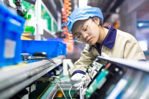 A worker inspecting an elevator signal system at a factory of Jiangsu WELM Technology last month