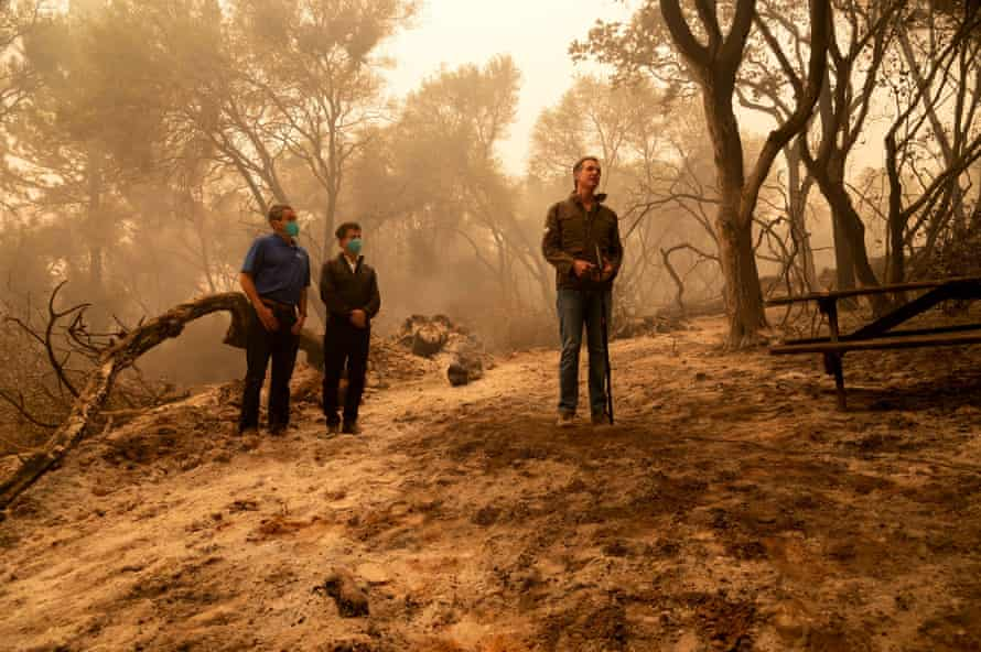 Gavin Newsom talks to the media after touring the damage from the North Complex fire outside of Oroville, California.