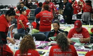 Members of the Culinary Union prepare packets before canvassing for Democratic candidates in Las Vegas on 17 October.