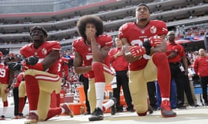 Eli Harold, Colin Kaepernick and Eric Reid kneel during the national anthem in 2016.