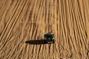 The Hispano Suiza Xite Energy Team's car speeds across the sand.