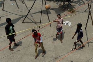 Kids play football at a deserted open-air laundry during a government-imposed nationwide lockdown as a preventive measure against coronavirus in Chennai on 8 April 2020.