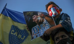 People gather to mourn the death of soccer legend Diego Maradona in Buenos Aires.