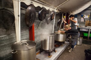 Help Refugees volunteers cooking and preparing food for the refugees at the Calais refugee camp