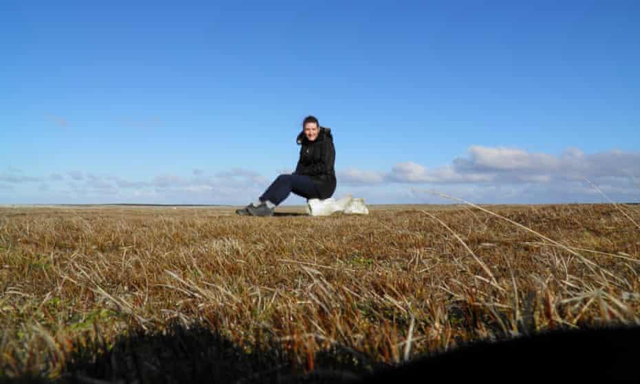Nell Stevens sitting on a whale vertebra, Bleaker Island.