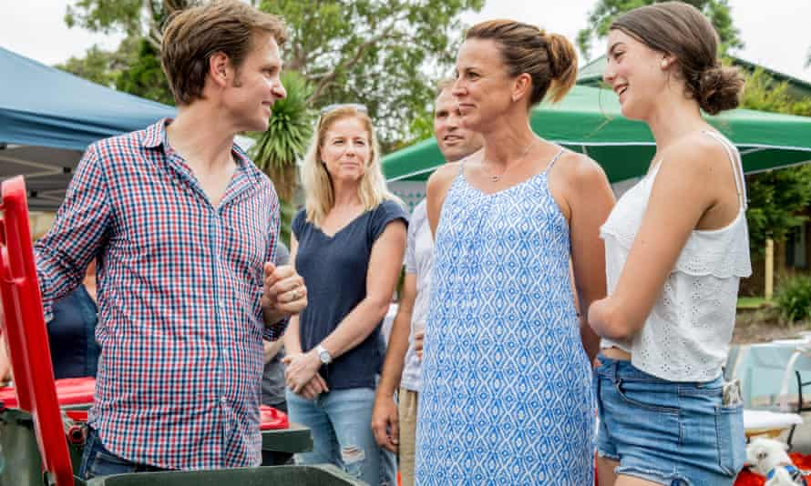 War on Waste presenter Craig Reucassel with the Grogan family and their bins