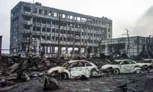 Burnt-out Volkswagen cars among the debris on the second morning after a series of explosions at a chemical warehouse hit the city of Tianjin, China.