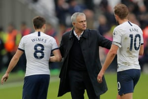 Tottenham Hotspur's new manager Jose Mourinho reacts with Harry Kane and Harry Winks at the end of his first match in charge.