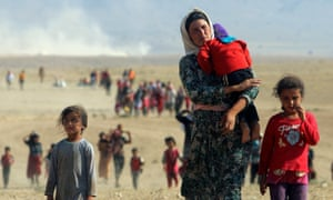 Yazidis fleeing their towns for Mount Sinjar as Islamic State forces advanced on them fours years ago.