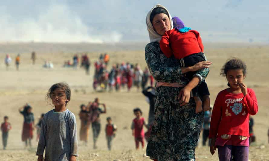 Displaced Yazidi people fleeing violence from Isis forces in Sinjar town.