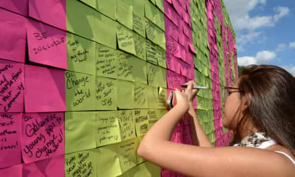 Participants write suggestions on the 'To Do' board during the South by South Lawn event at the White House.