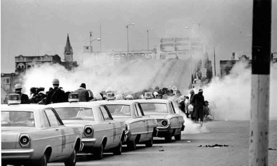 Tear gas fumes fill the air as state troopers, ordered by Governor George Wallace, to break up a demonstration march in Selma, Ala., on Bloody Sunday on 7 March 1965.