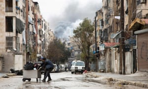 Civilians take shelter in a rebel-held neighbourhood in Aleppo