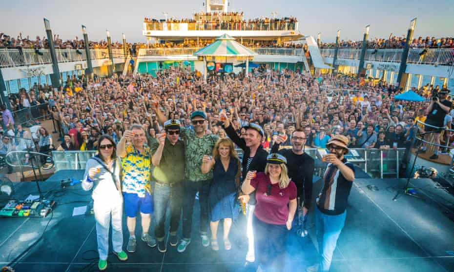 Fun ahoy! … Belle and Sebastian (Stuart Murdoch fourth from right) and fans on the indie festival cruise aboard the Norwegian Pearl.