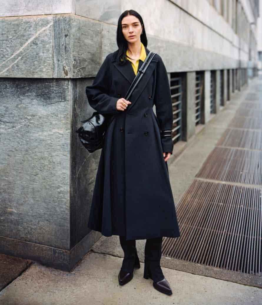 An image of a model on a street corner in Bottega Veneta Edition 01
