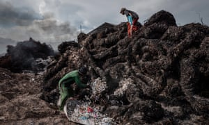 Workers prepare to burn plastic at a dump for imported waste in Mojokerto in East Java, Indonesia