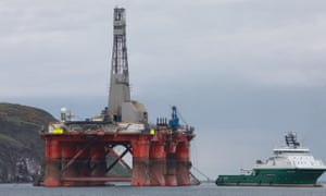 The oil rig in Cromarty Firth, Scotland, as it was being towed out to sea.
