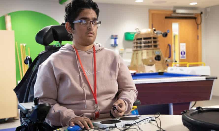 Farhan Aziz plays on the Xbox Adaptive Controller.