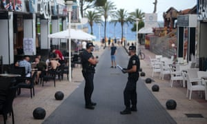 Police officers patrol at the resort of Magaluf on the Spanish Balearic island of Mallorca, Spain