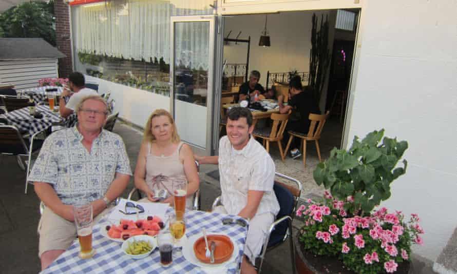 Sabine Roy, centre, and Thorston Falke, left, with Clint Buffington.