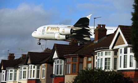 low flying airplane over suburban street