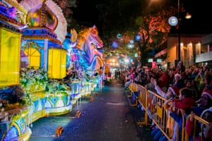 San José, Costa Rica: People attend a light festival parade in the main streets of the capital