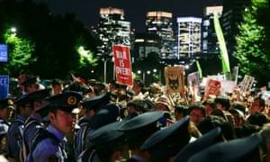 Japanese police block demonstrators outside Japan's parliament in Tokyo on Wednesday.