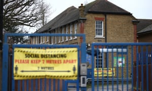 Social distancing signs at Coldfall primary school in Muswell Hill, London.
