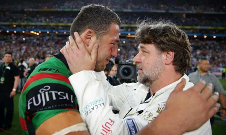 Rabbitohs player Sam Burgess is congratulated by Russell Crowe after 2014's grand final win.