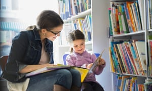 woman and child in library