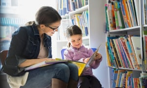 Woman and child reading in bookstore