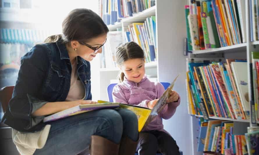 Woman and child reading in a library