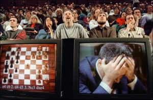 Man versus machine: chess enthusiasts watch Garry Kasparov in his final match against Deep Blue, New York, 11 May 1997.