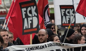 People holidng banners that read 'FCK AFD' as demonstrators take part in a protest against the Alternative for Germany party