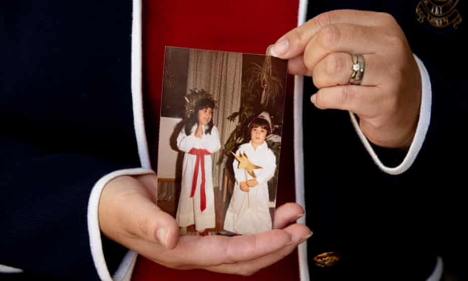 Maria Diemar holds a photograph showing her with her brother, Daniel Olsson.