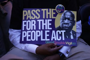 At a vigil for lawmaker and civil rights activist John Lewis, attendees urge passage of the For the People Act.