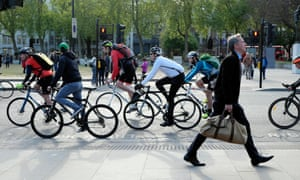Commuters walking and cycling to work.